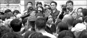 Government staff member addresses villagers